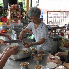 Volunteers preparing food for catering